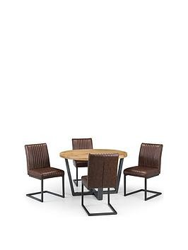 Save £90 at Very on Julian Bowen Brooklyn 120 Cm Solid Oak And Metal Round Dining Table + 4 Brooklyn Chairs